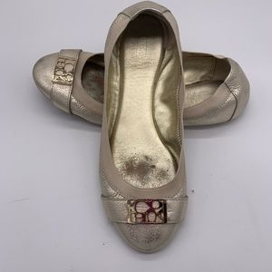 Coach gold soft leather flats with logo buckle